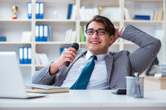The businessman singing in the office Royalty Free Stock Image