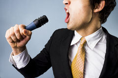 Businessman singing. Or talking passionately into a microphone Royalty Free Stock Image