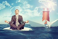 Businessman with sinking broken ship Stock Photos
