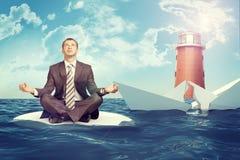 Businessman with sinking broken ship Stock Photos