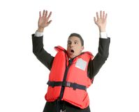 Businessman sinking in crisis, lifejacket metaphor Stock Images