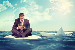Businessman with sinking paper boat Royalty Free Stock Photos