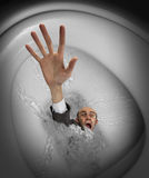 Businessman sinking in toilet bowl Royalty Free Stock Image