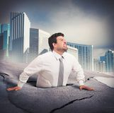 Businessman sinks into despair Stock Images