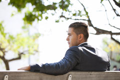 Businessman sit in the bench park Stock Photo