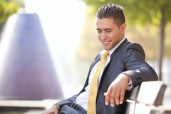 Businessman sit in the bench park Royalty Free Stock Image