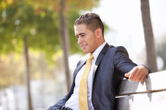 Businessman sit in the bench park Royalty Free Stock Photo