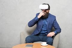 Businessman sit chair wear hmd explore virtual reality or ar. Business partner interact in virtual reality. New. Opportunity. Modern software for business royalty free stock images