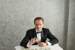 Businessman sit looking you and showing money an thinking about. Something. business concept Stock Photography