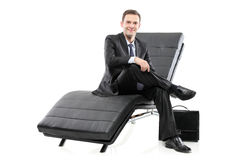 A businessman sited on a sofa Stock Photography