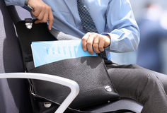 Businessman siting on a chair and geting out   documents with gr Stock Photos