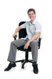 The businessman sits in an armchair Royalty Free Stock Photography