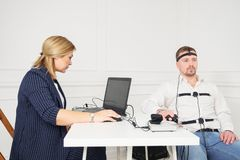 Businessman sits for a lie detector examination.  stock images