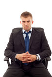 Businessman sits in office chair Stock Photography