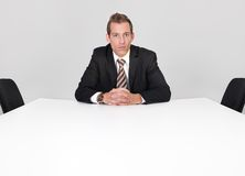 Businessman sitting alone Royalty Free Stock Image