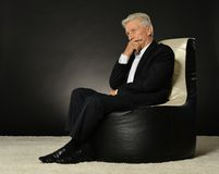 Businessman sitting in armchair Royalty Free Stock Photography