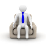Businessman sitting in an armchair. Stock Images