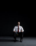 Businessman sitting in armchair. Business and office concept.  Royalty Free Stock Images