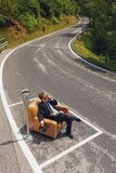 Businessman sitting on armchair in the middle of the road Royalty Free Stock Photo