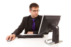 Businessman sitting behind desk at work Royalty Free Stock Image