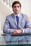 Businessman sitting behind his desk Royalty Free Stock Photo