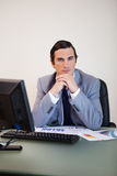 Businessman sitting behind his desk Stock Photo