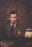 Businessman sitting behind table Royalty Free Stock Images