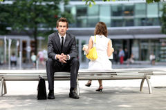 Businessman sitting on bench Royalty Free Stock Image