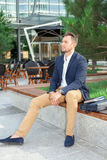 Businessman sitting on bench. Outdoors Royalty Free Stock Image