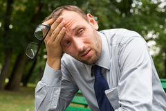 Businessman sitting on a bench in the park. Businessman sitting on a bench in the park Stock Photo