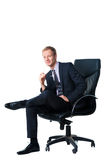 Businessman sitting in black office chair Stock Image