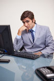 Businessman sitting bored at his workplace Royalty Free Stock Images