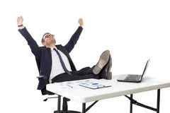 Businessman sitting, both foot on the table Stock Photos
