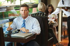 Businessman sitting in cafe Stock Image
