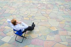 A businessman sitting and calling the street Royalty Free Stock Images