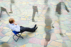A businessman sitting and calling the street Royalty Free Stock Photo
