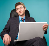 Businessman sitting on chair Stock Image