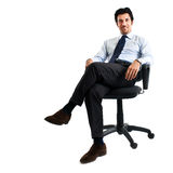 Businessman sitting on a chair Royalty Free Stock Image