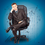 Businessman sitting on chair Royalty Free Stock Photos