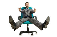 Businessman sitting in the chair Stock Photos
