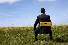 Businessman sitting in a chair Royalty Free Stock Image