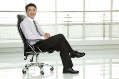 Businessman Sitting in Chair Stock Images