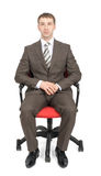 Businessman sitting on chair Stock Images