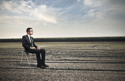 Businessman sitting on a chair Stock Photography