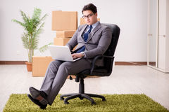 The businessman sitting on the chair in office Stock Image