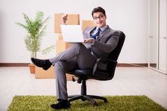The businessman sitting on the chair in office Stock Photography