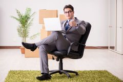 The businessman sitting on the chair in office Royalty Free Stock Photography