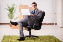 The businessman sitting on the chair in office Stock Images