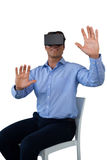 Businessman sitting chair while wearing vr glasses Royalty Free Stock Photos