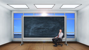 Businessman sitting in classroom Royalty Free Stock Image